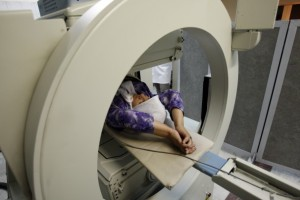 Iranian woman undergoing diagnostic scan